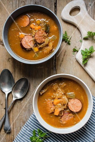 Flavoursome sauerkraut cabbage soup with smoked sausage (seen from above)