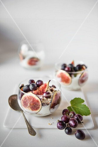 Fresh figs with Greek yoghurt, grapes and muesli for breakfast