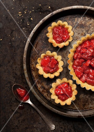 Strawberry tartlets in a cake tin