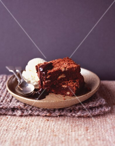 Brownies with chocolate sauce and vanilla ice cream
