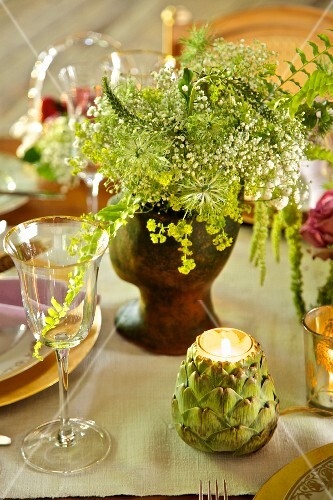 Artichoke-shaped tealight holder on festively set table