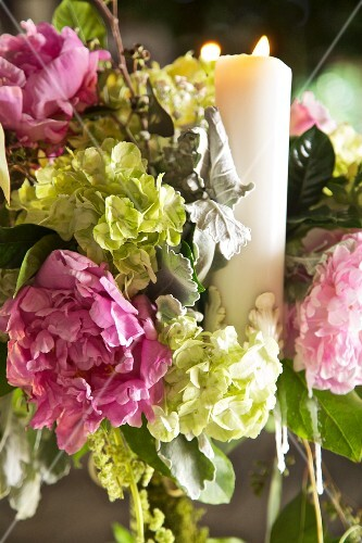Arrangement of hydrangeas and candle