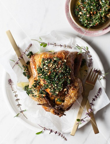 Roast chicken with lemon, herbs ans hand-chopped kale and almond pesto