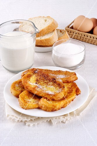 French toast on a plate in front of ingredients