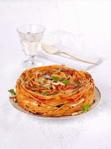 Italian bucatini timbale with tomato sauce