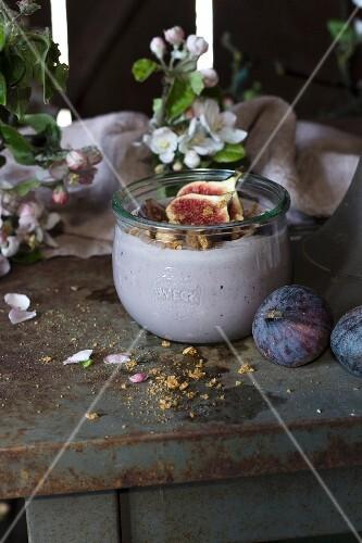 Plum and fig yoghurt in a glass jar