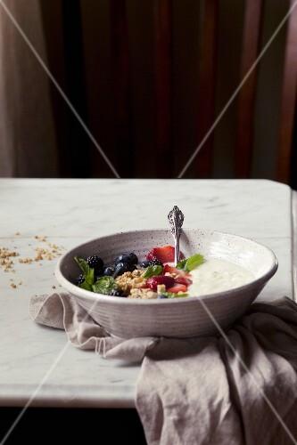 Yogurt with fresh berries and porridge oats in a bowl