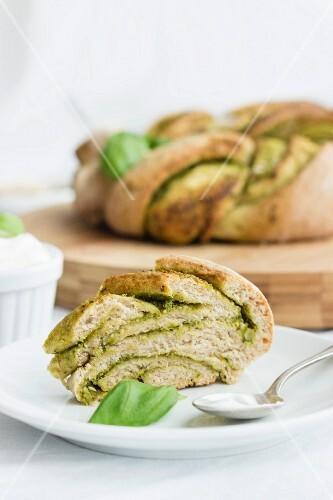 A pesto bread wreath with basil
