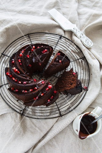 Slices of chocolate Bundt cake garnished with pomegranate seeds