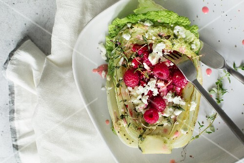 Chinese cabbage with fresh cheese and raspberries