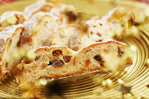 Christmas stollen on a gold plate