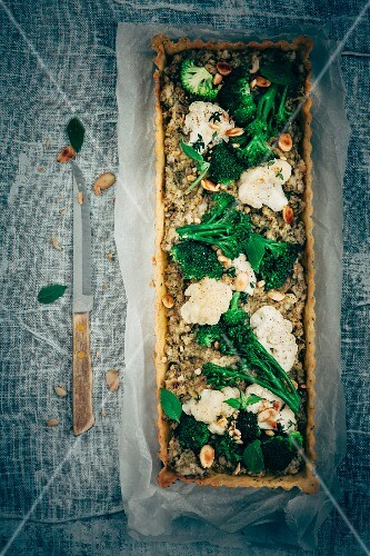 Broccoli, bimi and cauliflower tarte, almonds, fresh thyme and fresh basil leaves
