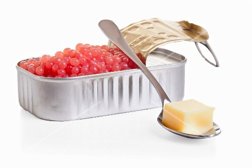 Raspberry caviar with vanilla sauce (molecular cuisine)