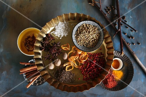 Bowls of spices on a blue background