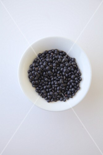 Black beluga Lentil on a white plate.