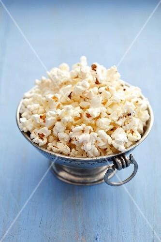 Popcorn in silver bowl