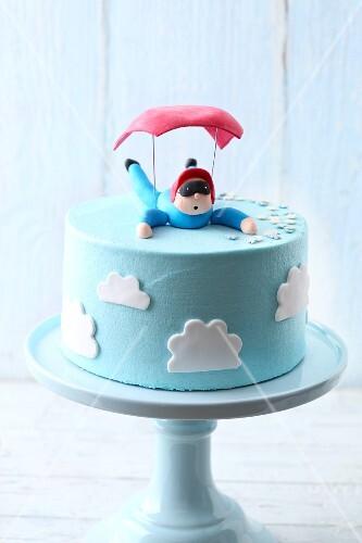 Light blue 'Parachute Landing' buttercream cake with marshmallow fondant