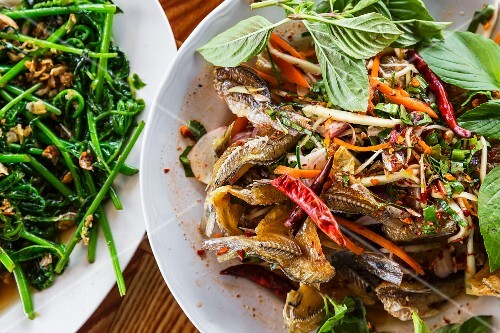 Thai salad of small fried fish with mango chillie and herbs (Sangkhlaburi, Thailand)