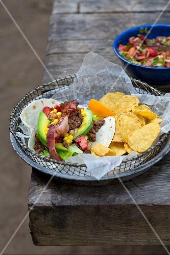 Tortilla with mince, corn, avocado, salsa and tortilla chips