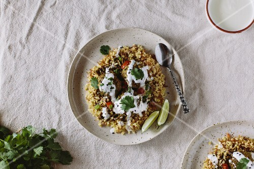 Curried Lentil Meatballs served on bulgur pilaf and topped with yogurt sauce
