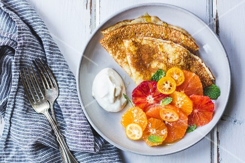 Crepes with a citrus fruit side