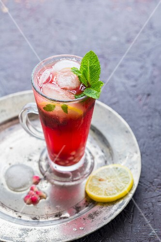 A chilled glass of Pomegranate Mojito