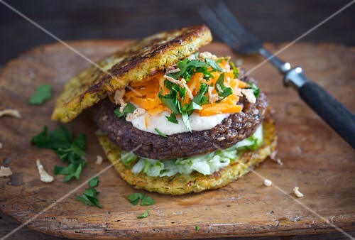 Vegan potato and turnip burgers, bean patties, date oat cream and a raw vegetable salad