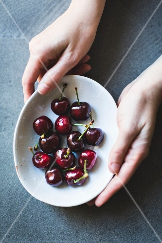 Ripe red cherries in a bowl
