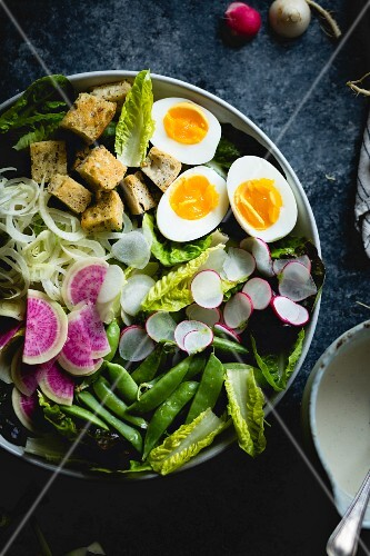 Spring greens salad with fennel, radish and miso-buttermilk dressing