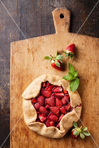 Strawberry pie on wooden background
