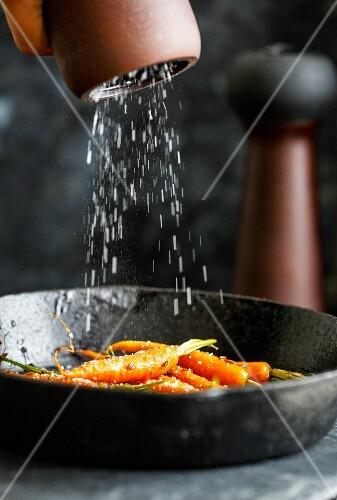 Honey Glazed Carrots on a cast iron pan