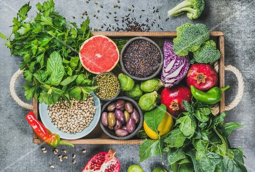 Fresh vegetables and fruits, seeds, cereals, beans, spices, superfoods, herbs, condiment in wooden box