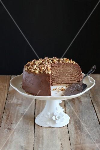 Chocolate crepe cake with roasted walnuts