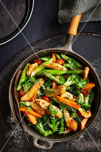 Brightly coloured pan-fried vegetables with balsamic chicken