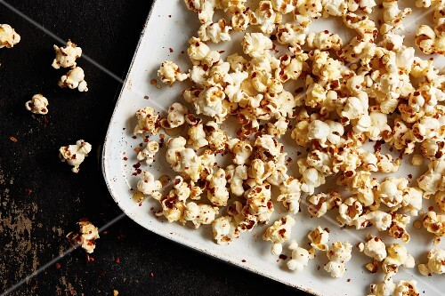 Homemade sweet and spicy popcorn with chilli and maple syrup