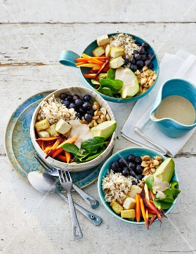 Buddha bowls with tofu, rice and vegetables