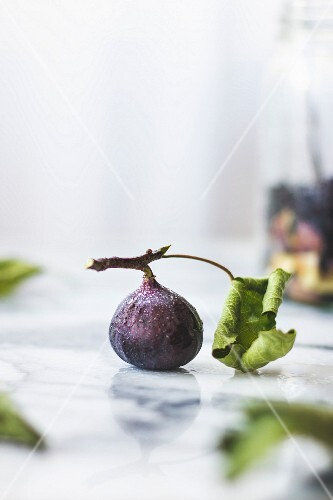 Fig with a leaf, on a marble background