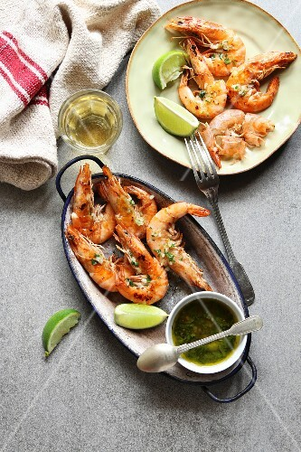 Grilled prawn with garlic salsa sauce on an enamel plate
