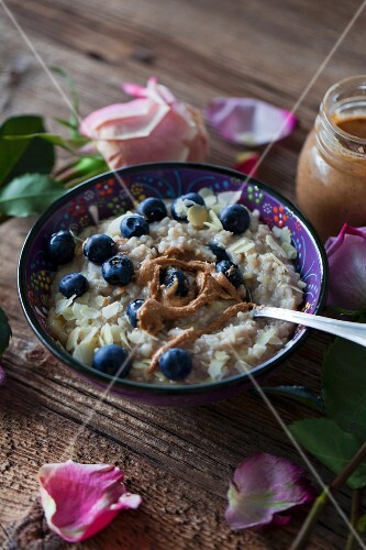 Porridge, blueberries and almond butter for healthy breakfast