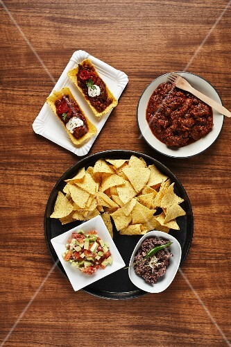 Tacos with guacamole, chilli con carne and bean paste