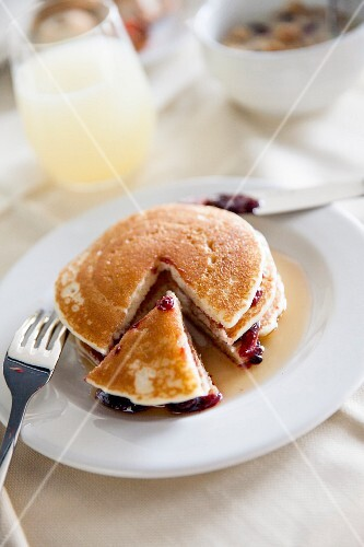Pancakes with maple syrup and berry jam