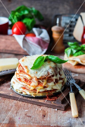 Pancakes baked as lasagna and topped with basil