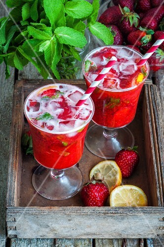 Strawberry lemonade in two glasses with straws