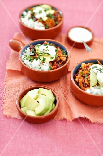 Chili con carne with rice and avocado