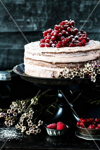 Semi-naked cake with currants and raspberries