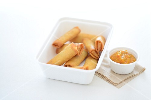 Spring rolls and a dip in take away cartons