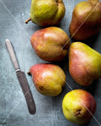 Fresh pears with a knife