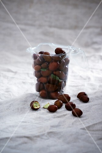 A cup with fresh red dates (Ziziphus jujuba)