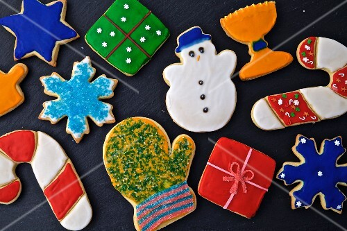 Colourful decorated Christmas cookies on a dark background