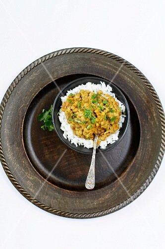 Indian Vegetarian Dhal Curry with Jasmine Rice on a Rustic plate